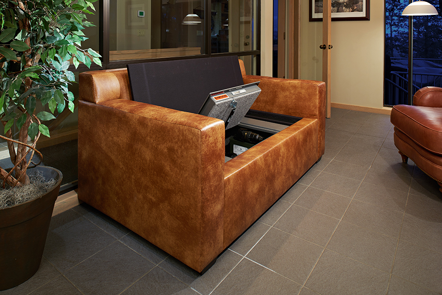 THIS BULLETPROOF COUCH COMES WITH ITS OWN HIDDEN GUN SAFE – MAXIM
